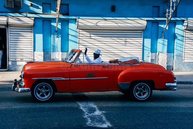 A beautiful classic car in Havana, Cuba. A beautiful red classic convertible car parked on the street in Havana, Cuba stock photography