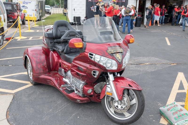 A beautiful red custom tricycle on display at the 2018 Sturgis Motorcycle Rally. AUGUST 5, 2018, STURGIS, SD: 500,000 bikers bring their motorcycles to Sturgis royalty free stock photos