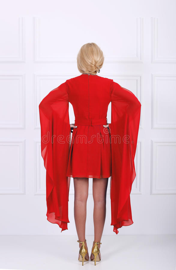 Beautiful red dress. Tall young woman wearing an elegant red dress, back view stock photos