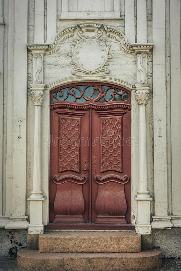 Beautiful red dual door with white pillars  and vaulted top royalty free stock photo