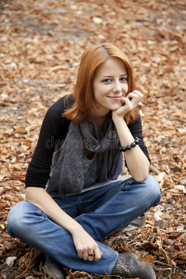 Download Beautiful Red-haired Girl In Autumn Park Stock Photo - Image: 15849742