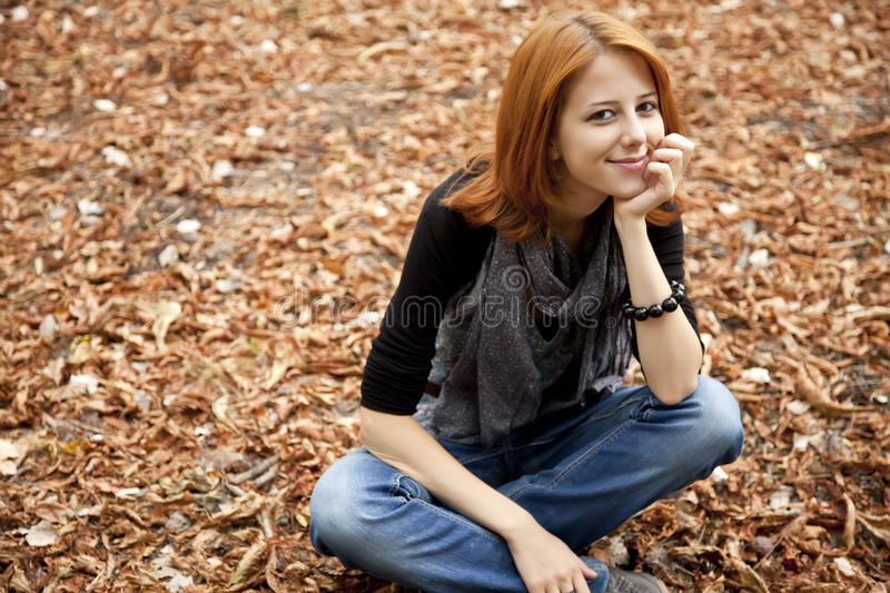 Download Beautiful Red-haired Girl In Autumn Park Stock Photo - Image: 15849784