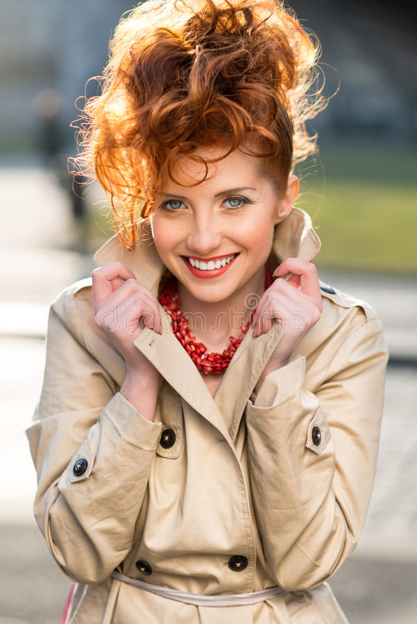 Beautiful red-haired girl with charming smile stock images