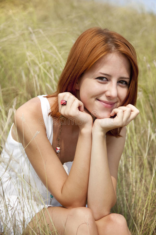Download Beautiful Red-haired Girl At Grass Stock Photo - Image of relaxation, lifestyle: 15607916