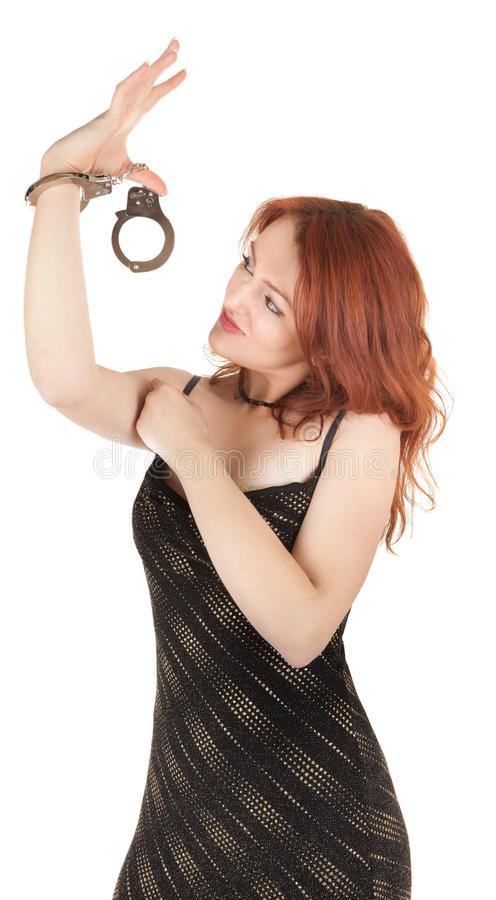 Download Beautiful Red-haired Girl In Handcuffs Stock Image - Image: 12711435