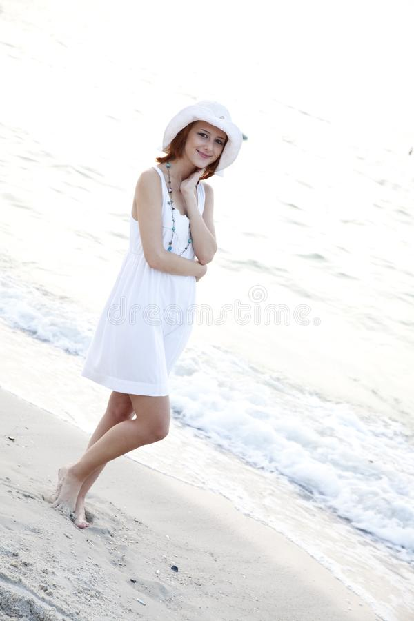 Download Beautiful Red-haired Girl In Hat On The Beach Stock Photo - Image of paradise, beach: 15639550