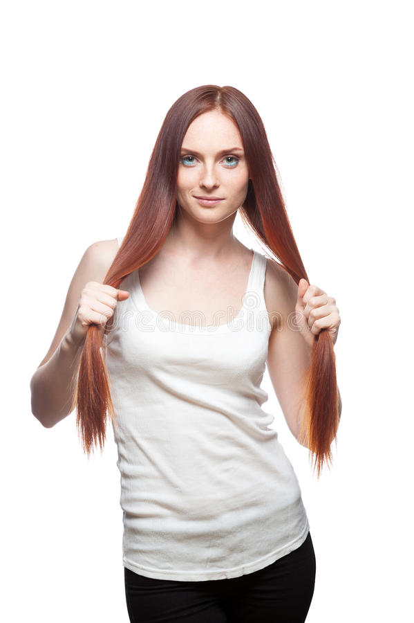 Download Beautiful Red Haired Girl Holding Her Hair Stock Photo - Image: 28357540