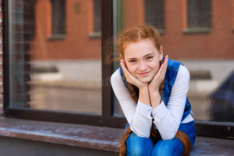 Download Beautiful red-haired girl stock photo. Image of game - 73777598