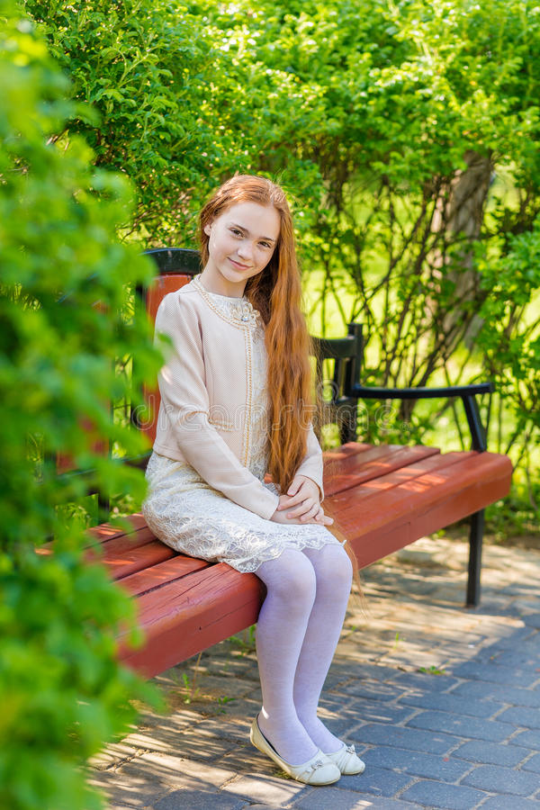 Download Beautiful red-haired girl stock image. Image of vitality - 73777467