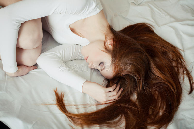 Download Beautiful Red-haired Girl Sleep On The Bed Stock Image - Image: 18894277