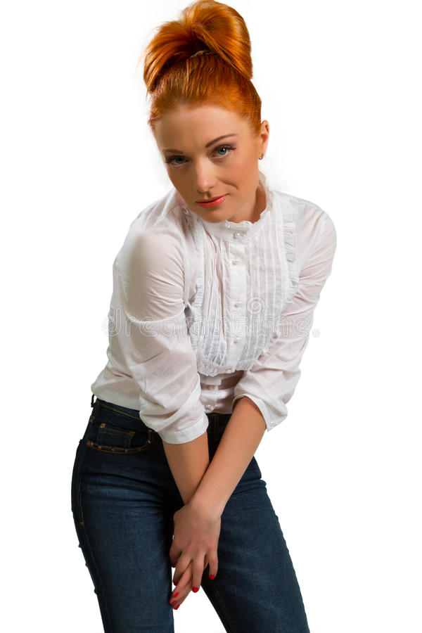 Beautiful red-haired girl in a white blouse royalty free stock photos