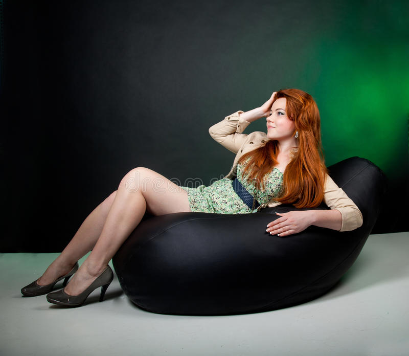 Download Beautiful red haired woman stock image. Image of chair - 20823971