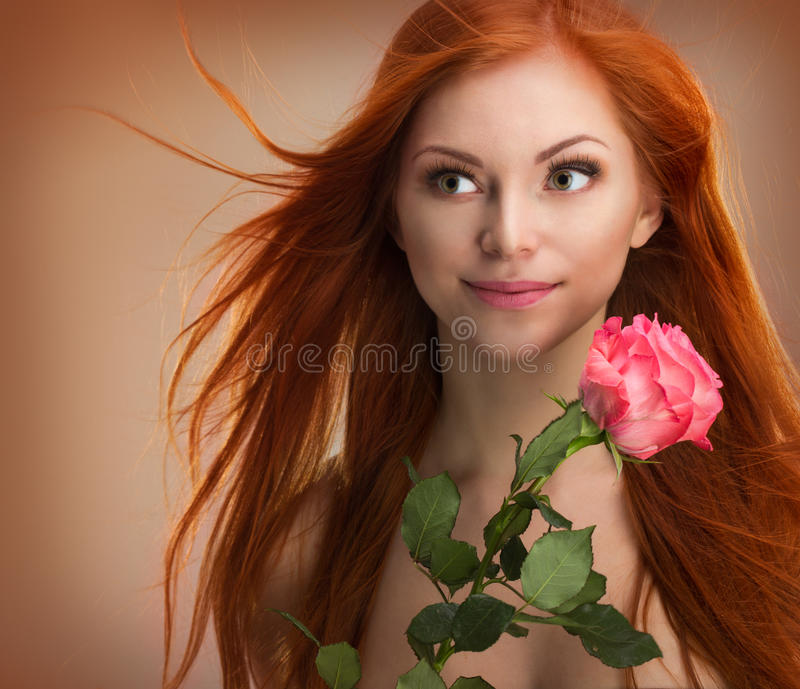Beautiful red-haired woman. Beautiful young red-haired girl, studio stock images