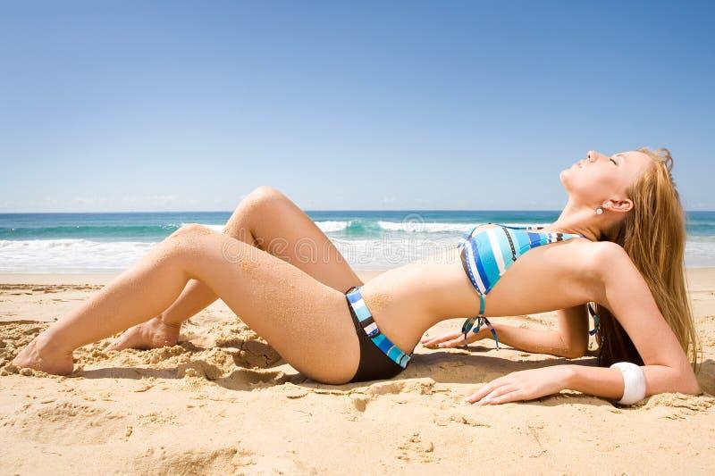 Beautiful red head in bikini stock photos