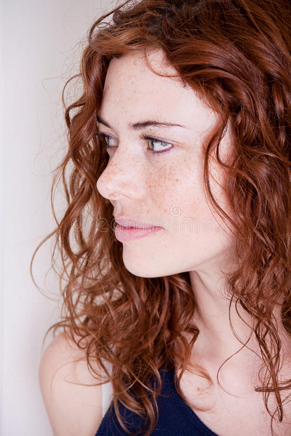 Beautiful red head woman with freckle smiling stock image