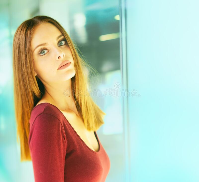 Beautiful model, elegant pose, subway background stock image