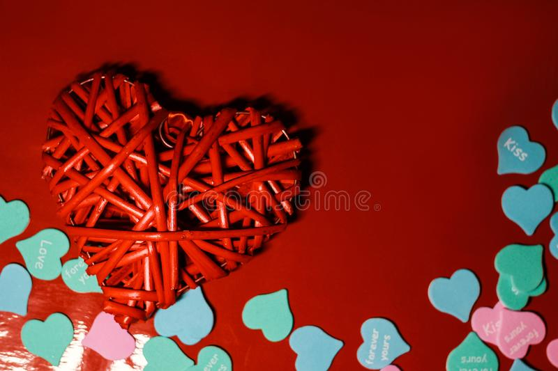 Beautiful red heart closeup with decorations from multi-colored hearts.  royalty free stock photos