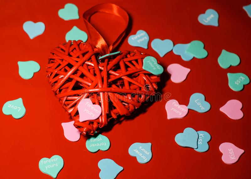 Beautiful red heart closeup with decorations from multi-colored hearts.  royalty free stock images