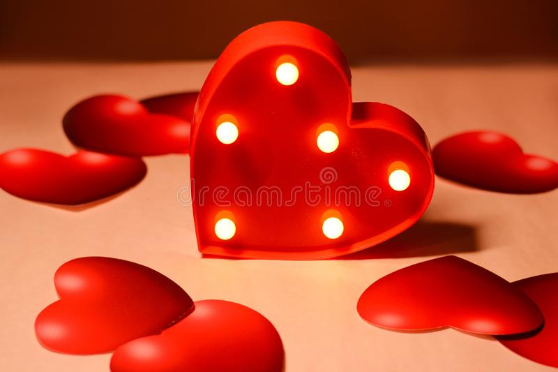 Beautiful red heart closeup with decorations from multi-colored hearts.  royalty free stock photography