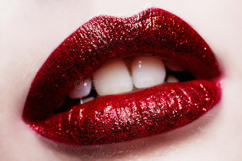 Beautiful red lips with glitter royalty free stock image