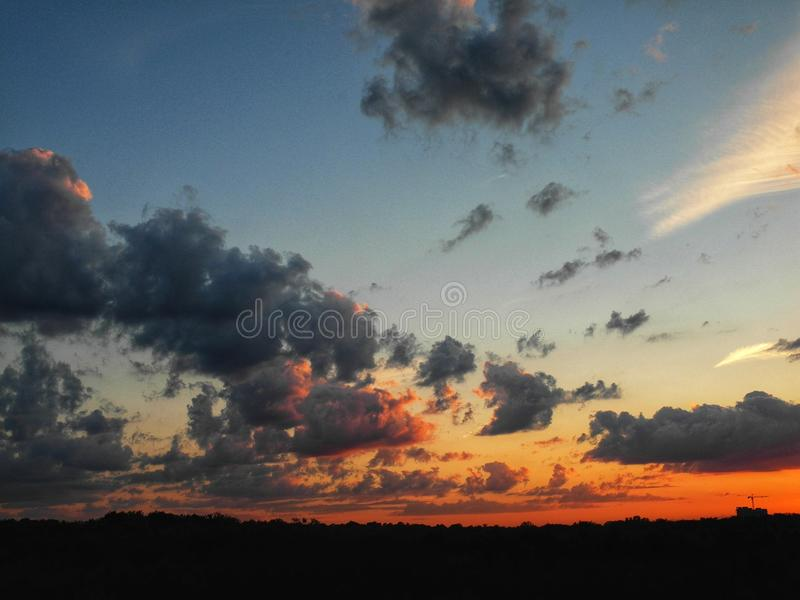 Beautiful red-orange sunset. Sky and clouds in beautiful sunset stock images