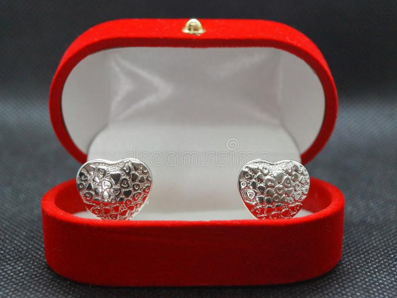 A beautiful red ring casket with two silver hearts stock images