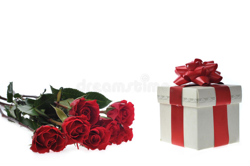 Beautiful red roses and present. With ribbon stock photography