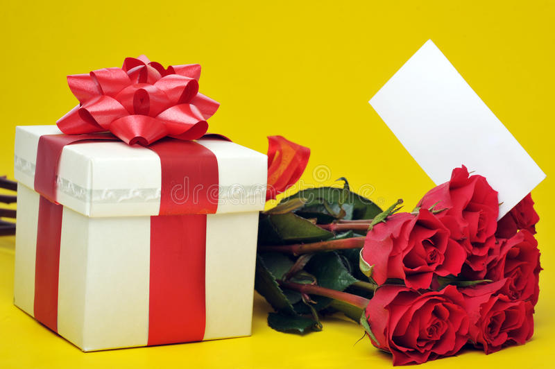 Beautiful red roses and present. Beautiful red roses ,present with ribbon and name card stock photography
