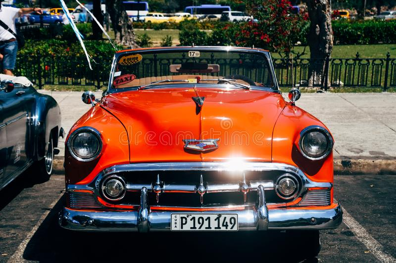 A beautiful red classic car in Havana, Cuba. A beautiful red shiny classic car parked in Havana, Cuba royalty free stock images