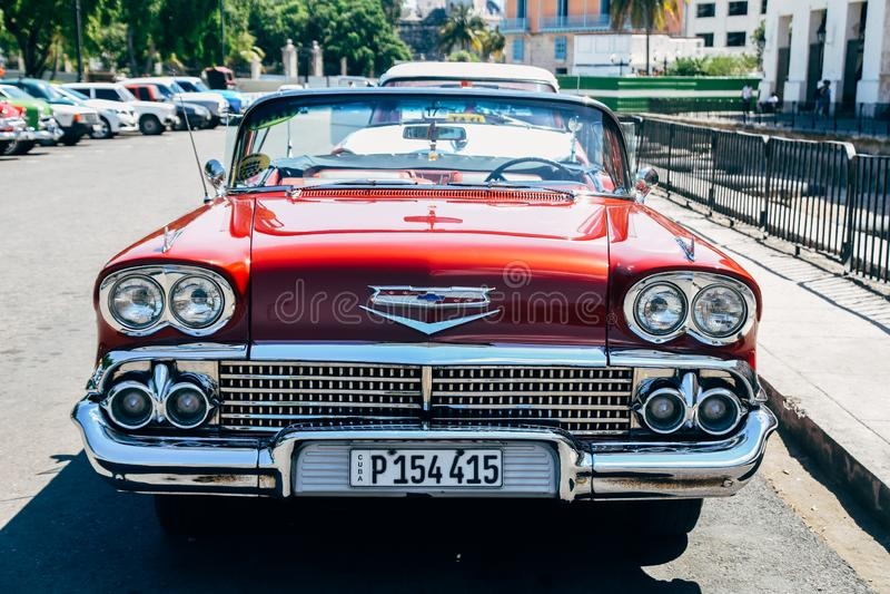 A beautiful red classic car in Havana, Cuba. A beautiful red shiny classic car parked in Havana, Cuba stock images