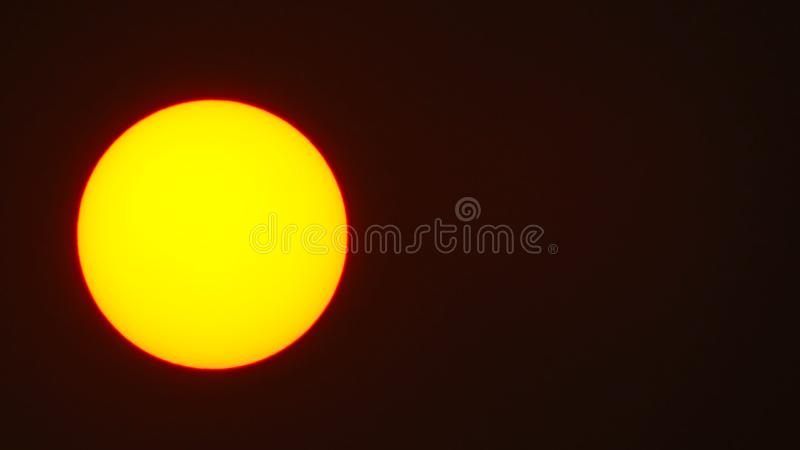 Beautiful red sky behind the sun royalty free stock photography