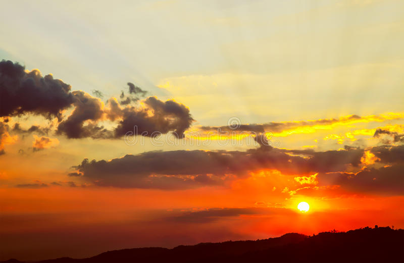 Beautiful red sky with sunbeams and clouds, sunset on high mount stock photography