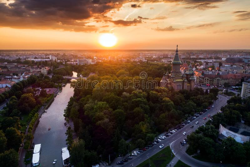 Beautiful red sunset in aerial view from Timisoara. Taken by a professional drone - TimiÈ™oara Orthodox Cathedral, Bega and Central Park royalty free stock photo