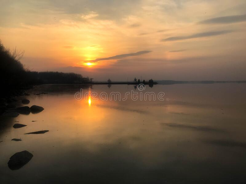 Beautiful red sunset over the horizon of the water in the river, sea, ocean, lake.  royalty free stock photo