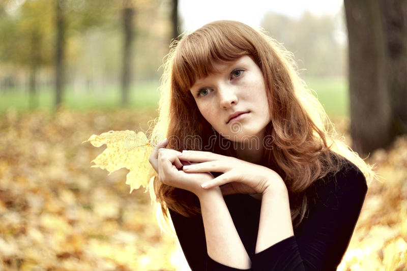 Beautiful Redhaired Girl Sitting Alone Stock Photos - Image 28668363-4290
