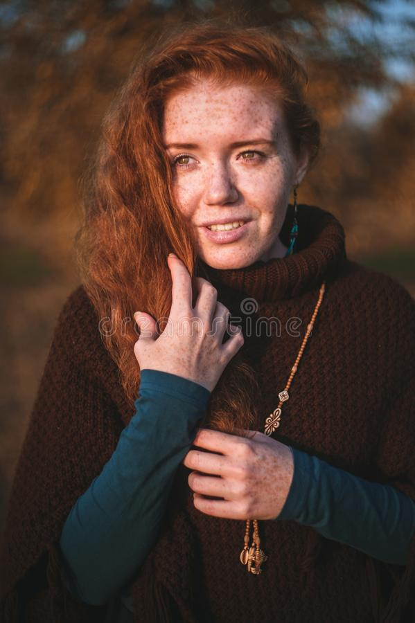 Beautiful redhaired girl at sunset. stock image