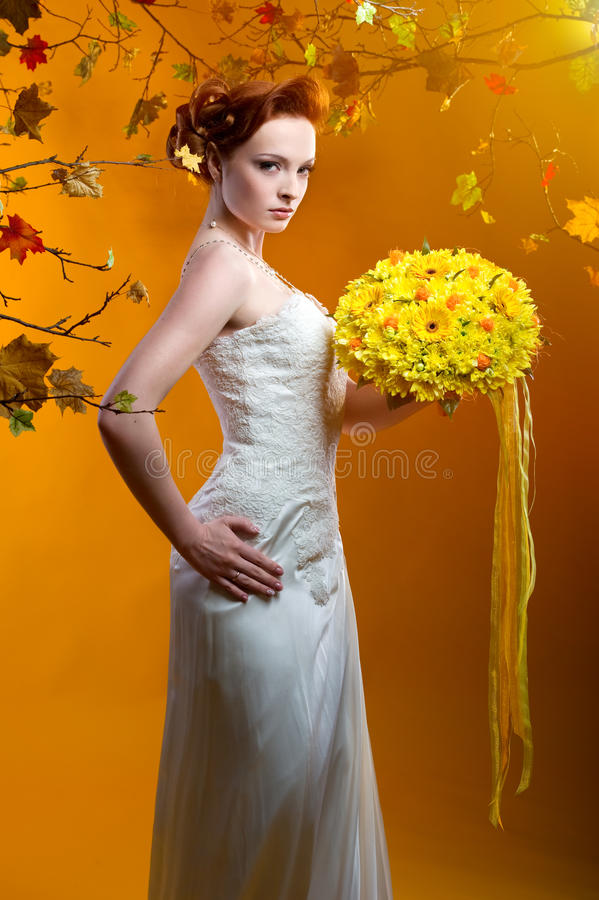 Beautiful redhead bride indoors royalty free stock images
