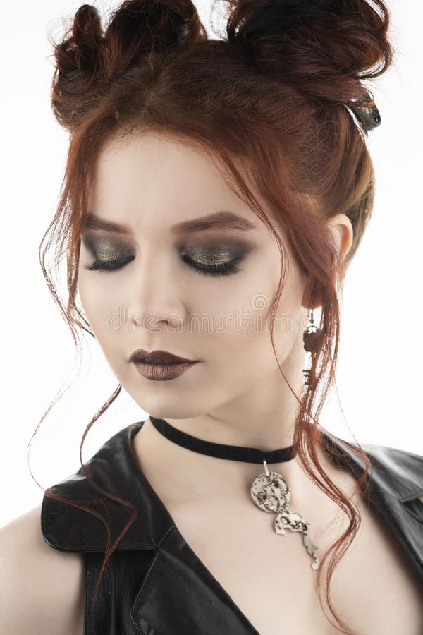 A beautiful redhead cosplayer girl wearing a Victorian-style steampunk costume with big breasts in a deep neckline. Isolated on stock image