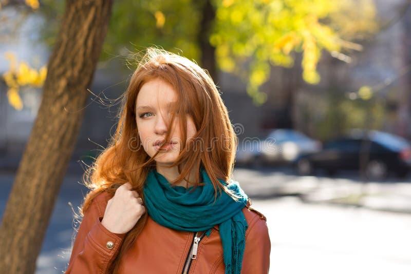 Beautiful redhead female in the street stock photos