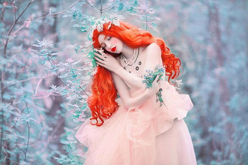 Beautiful redhead fine art princess with necklace on the neck. Young unusual woman with long hair, red lips, pale skin on bkue spr. Ing background. Ancient stock image