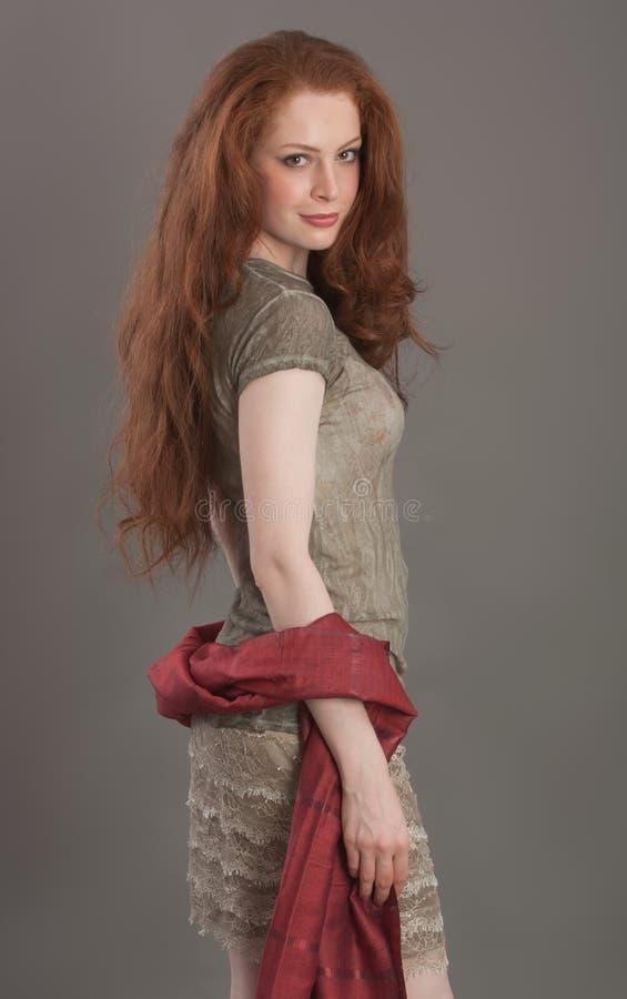 Beautiful redhead girl. Looking at camera stock photo