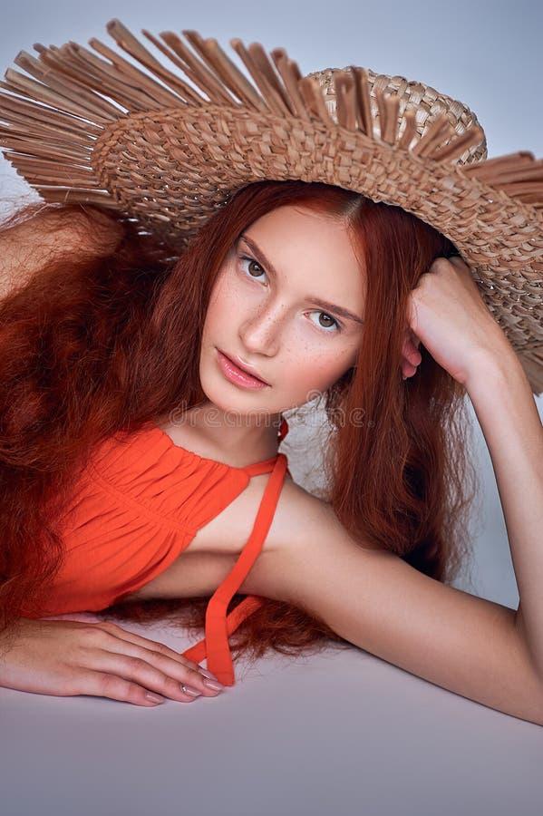 Beautiful Redhead Woman Posing At Sunny Day. Walks Along