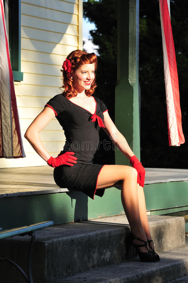 Beautiful redhead pinup girl royalty free stock photo