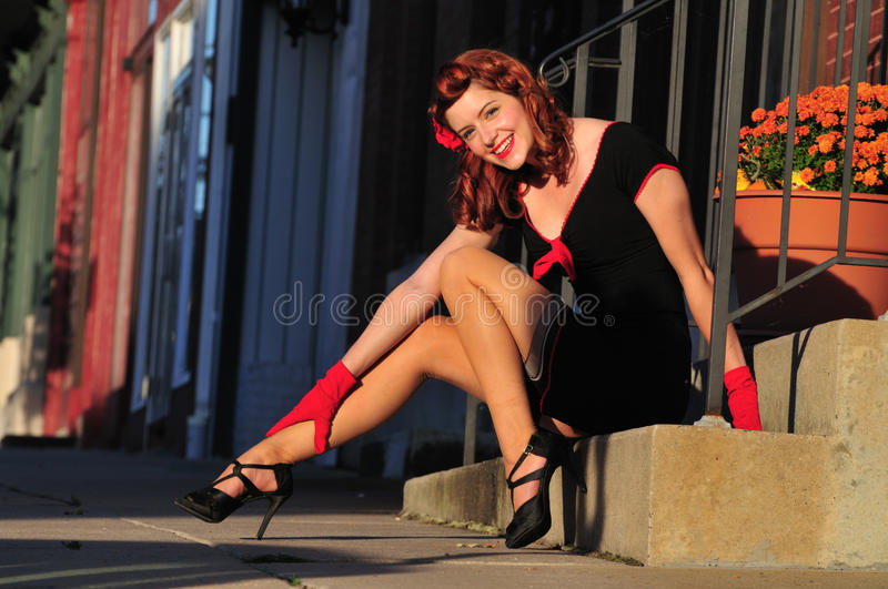 Beautiful redhead pinup girl stock image