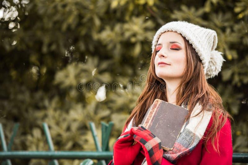 Beautiful Redhead reading a book stock image