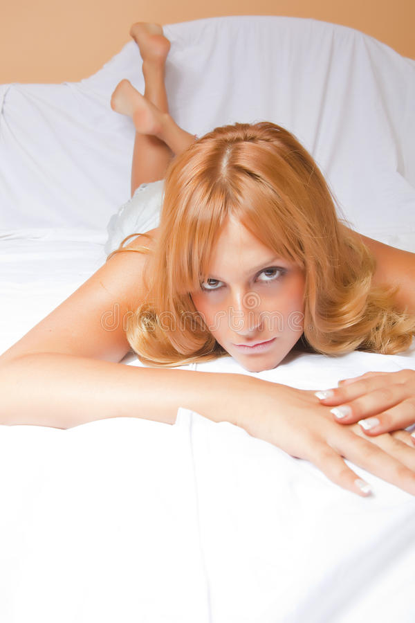 Beautiful Redhead Woman In Bed Royalty Free Stock Photography