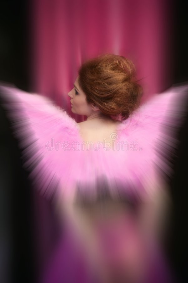 Beautiful redhead woman with pink wings stock photos