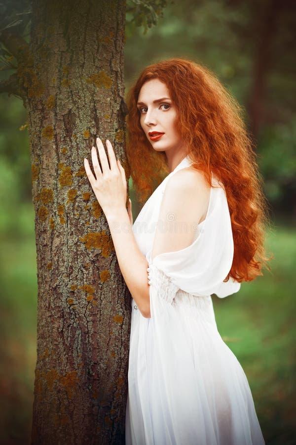 Beautiful Redhead Woman Wearing White Dress Stands Near ...