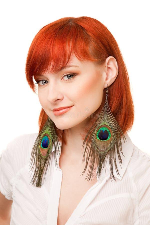 Free Beautiful Redhead Woman With Peacock Earrings Stock Photos - 9417773