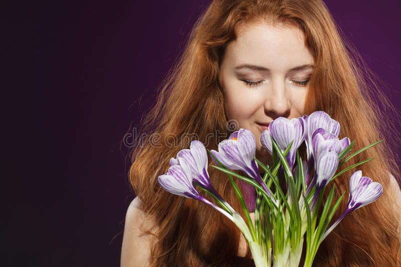 Download Beautiful Redheaded Female Smelling The Crocuses Stock Photo - Image: 28448908